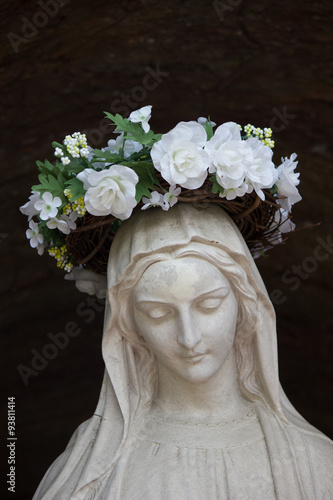 Statue of the Virgin Mary with a crown of flowers