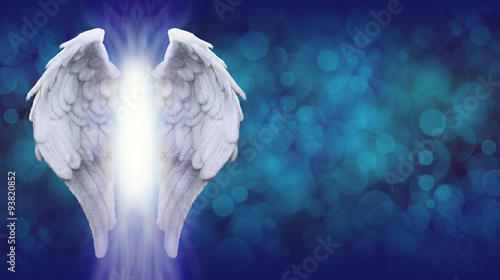 Vászonkép Angel Wings on Blue Bokeh Banner    - Wide blue bokeh background with a large pa
