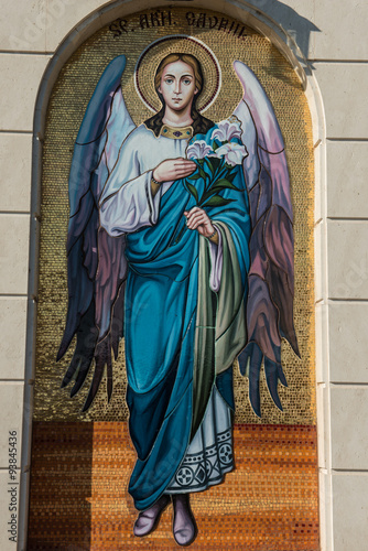 Fotomural Religious painting representing an angel with flowers