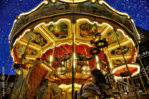 A rotating Merry-go-round at The Christmas Market of Frankfurt, Poster