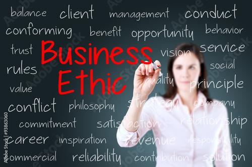 Fotografie, Obraz  Business woman writing business ethic concept. Blue background.