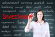 Business woman writing investment concept. Blue background.