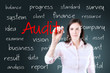 Young business woman writing audit concept