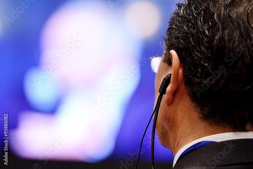 Fotografía  Man using translation headphones