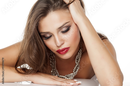 Fotografie, Obraz  a young beautiful woman posing with a big necklace