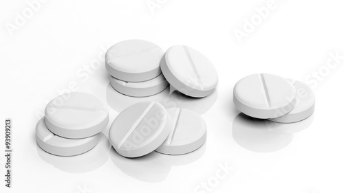 Photo White tablets, isolated on white background.