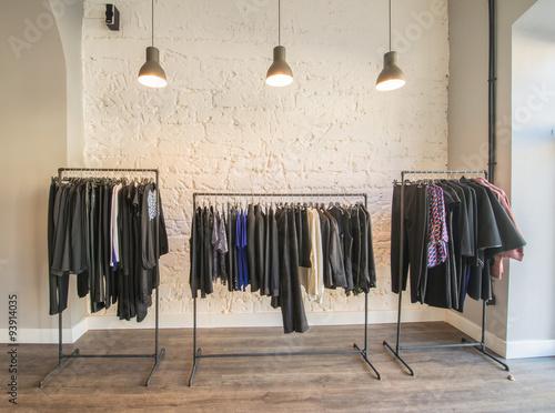 Obraz Interior of fashion clothing shop - fototapety do salonu