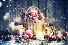 Christmas Gifts In Basket And Burning Candle. Vintage Style