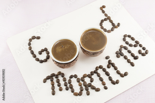 Photo  Two cups of coffee forming note