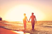 Honeymoon Couple On Beach In Loving Relationship