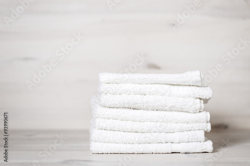 Fotografie, Obraz  stack of spa towels on white wooden table