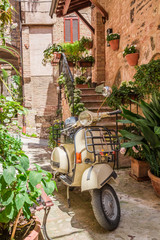 Fototapeta Motor Vintage scooter on the beautiful porch in italy