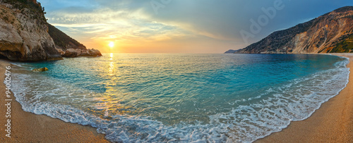 Spoed Foto op Canvas Zee zonsondergang Sunset on Myrtos Beach (Greece, Kefalonia, Ionian Sea).