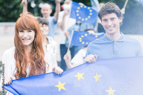 Foto  Community workers with flags