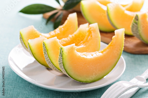 Ripe cantaloupe slices on a plate