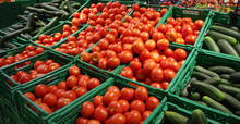 Fresh Red Tomatoes And Cucumbers At The Market