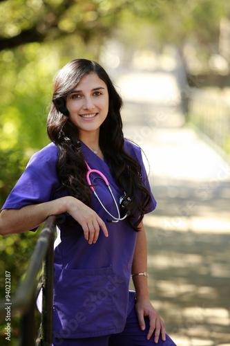 Fotografie, Obraz  Outdoors Portrait of beautiful nurse/doctor