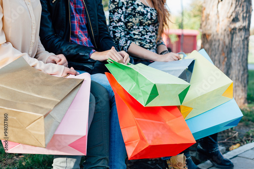 Fototapety, obrazy: Closeup of girls holding colorful shopping bags