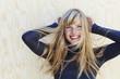 Leinwanddruck Bild - Gorgeous windswept blond woman, portrait
