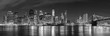 Leinwanddruck Bild - Black and white New York City at night panoramic picture, USA.
