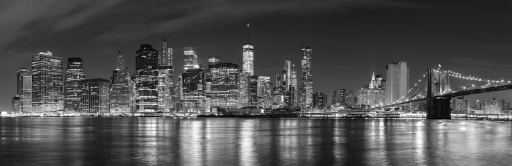 Black and white New York City at night panoramic picture, USA.