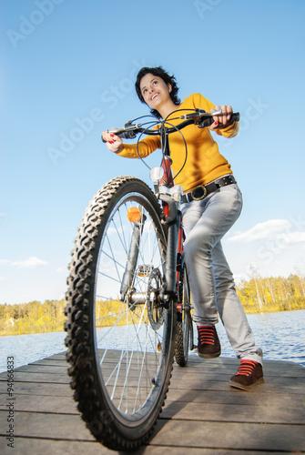 Aluminium Prints Cycling Beautiful girl riding bicycle