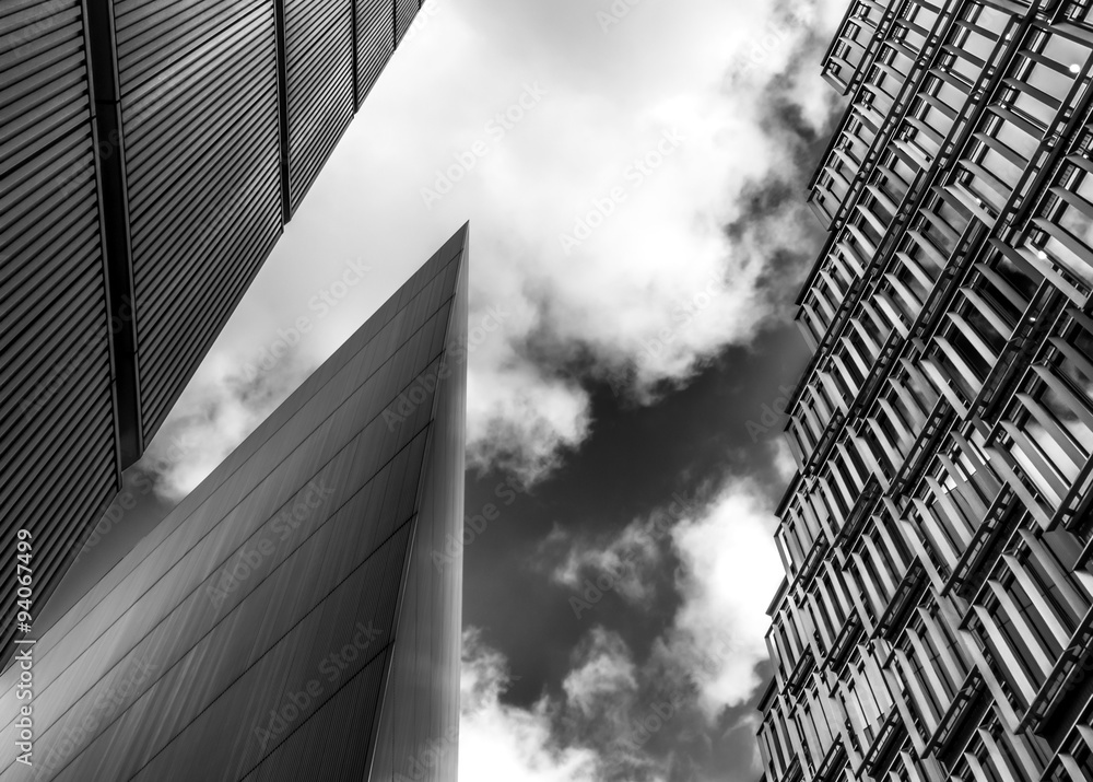 Fototapeta Black and white image of steel and glass skyscrapers of London against a cloudy sky