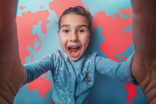 Teen Girl Shouting Stretched Her Arms Behind World Map
