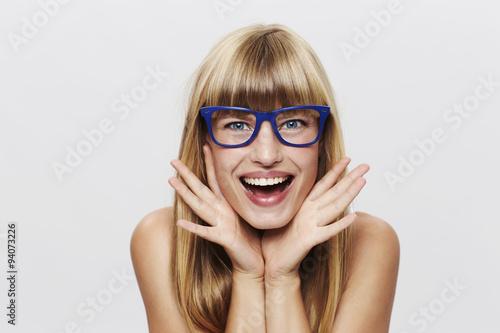 Fotografía  Young blond woman in blue spectacles, portrait