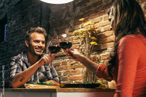 Young Couple Dining in a Rustic Apartment
