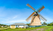 Beautiful And Traditional Thatched Windmill In German North Sea Village