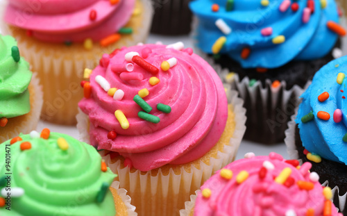 fototapeta na lodówkę Multicolored Cupcakes Isolated on a White Background
