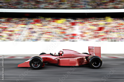 Fototapeta Motor sports red race car side view on a track leading the pack with motion Blur