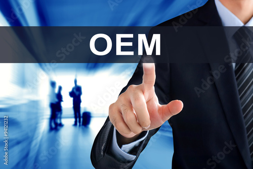 Businessman hand touching OEM (or Original Equipment Manufacture) tab on virtual Wallpaper Mural