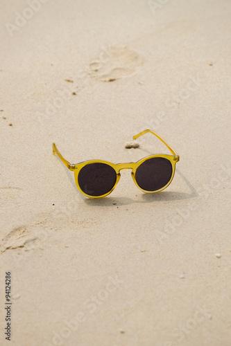 Photo  Summer Beach with a Sunglass, Sunglass on the Sand