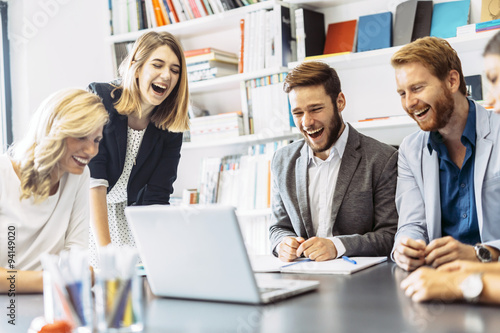 Fototapeta Cheerful people laughing in office obraz