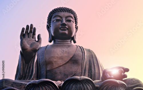 Buddha statue at Po Lin, Hong Kong. Bright light from hand.