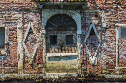 Photo  Old disused warehouse in Venice Italy decorated like a Cyberman Robot