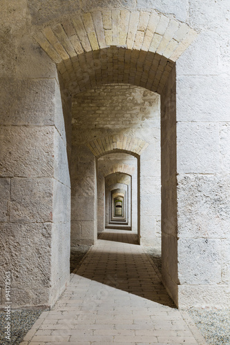 Castle tunnel interior with a series of symmetric arches in a bastion fortress.