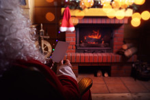 Santa Claus With A Letter From A Child