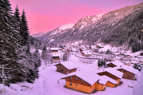 Foto op Plexiglas Purper Cityscape of the town of Chatel in the Portes du Soleil in France on a pink morning. HDR