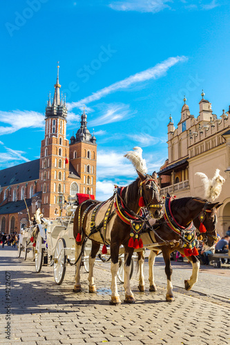 Fototapeta Horse carriages at main square in Krakow obraz