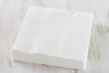 Paper Napkin On White Wooden Background