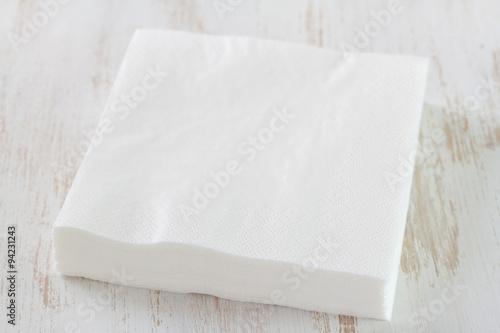 Fotografie, Obraz  paper napkin on white wooden background