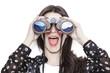 Leinwanddruck Bild Girl portrait looking at mountains through binoculars