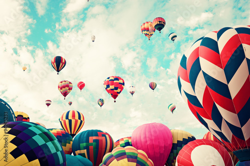 Vintage hot air balloons in flight