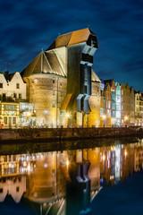 Fototapeta Do biura The riverside with the characteristic Crane of Gdansk, Poland.