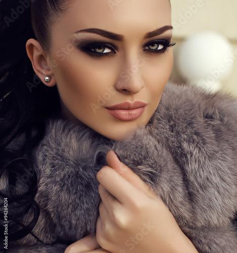 gorgeous woman with long dark hair wears luxurious fur coat Canvas Print