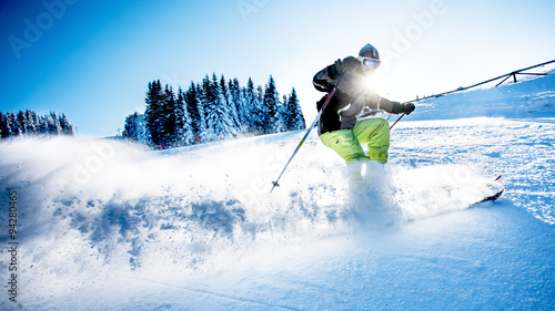 Spoed Foto op Canvas Wintersporten Man skiing downhill