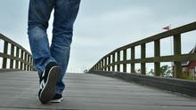 Man Crossing The Wooden Bridge